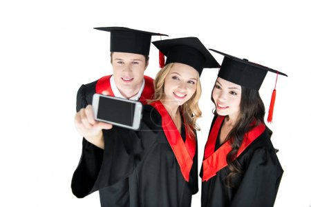 Photo for Young happy students taking selfie on smartphone isolated on white - Royalty Free Image