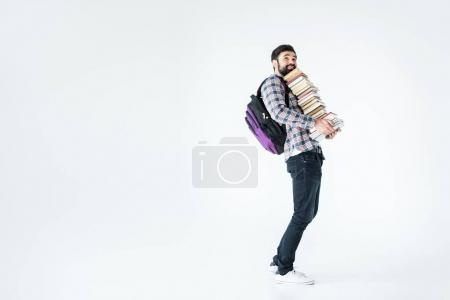 Photo pour Full length of bearded student with pile of books  isolated on white with copy space - image libre de droit