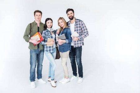 vier Schüler mit Büchern
