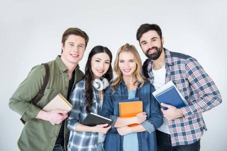 Photo for Four young students in casual clothes holding books isolated on white - Royalty Free Image