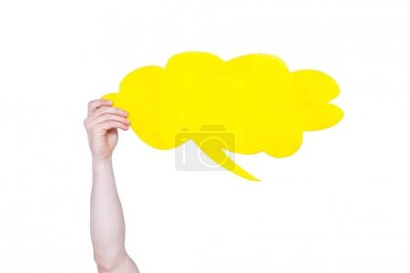 Photo for Person holding yellow empty speech bubble with copy space isolated on white - Royalty Free Image