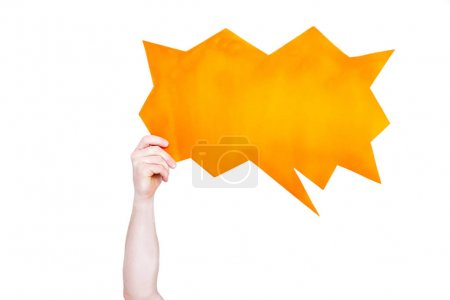 Photo for Person holding orange empty speech bubble with copy space isolated on white - Royalty Free Image