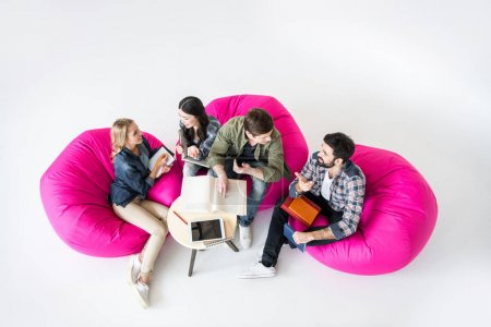 students sitting on beanbag chairs