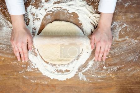 child making pizza dough
