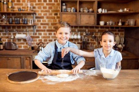 children making pizza dough