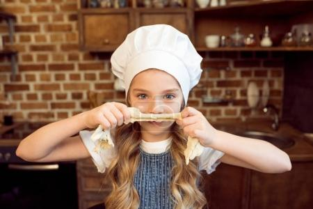 girl playing with raw dough