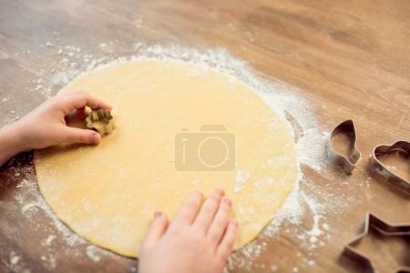 Photo for Partial view of boy making shaped cookies with cookie cutter - Royalty Free Image