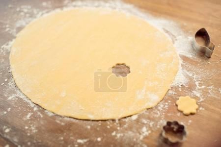 Photo for Close up view of raw dough and cookie cutters on table - Royalty Free Image
