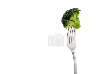 Photo for Fresh broccoli on fork isolated on white. healthy lifestyle concept - Royalty Free Image