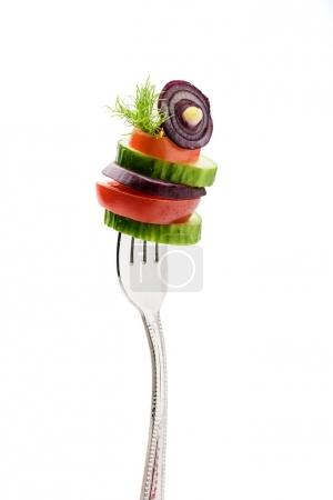 sliced vegetables on fork
