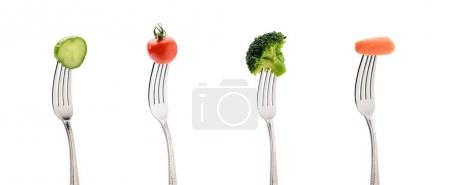 Photo for Cucumber, cherry tomatoe, carrot and broccoli on forks isolated on white. healthy lifestyle concept - Royalty Free Image