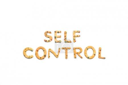 Photo for Top view of self control lettering made from sweets isolated on white, healthy living concept - Royalty Free Image