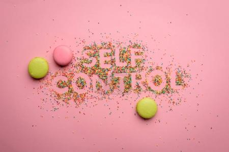 Photo for Top view of self control lettering made from candies isolated on pink, healthy living concept - Royalty Free Image