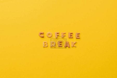 Photo for Coffee break lettering made of crisps isolated on orange - Royalty Free Image