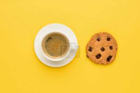 Photo for Top view of cup of espresso coffee and chocolate cookie - Royalty Free Image