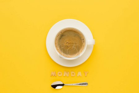 Photo for Top view of cup of espresso coffee, spoon and monday lettering - Royalty Free Image