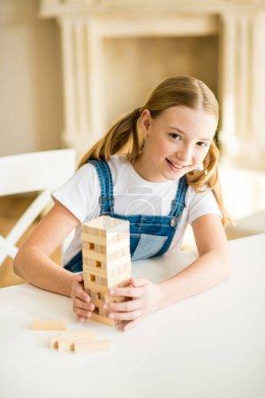 Girl playing jenga game