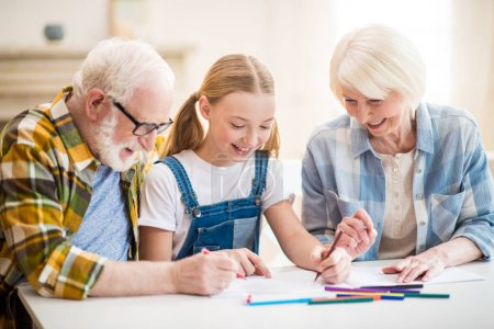 Girl with grandparents drawing