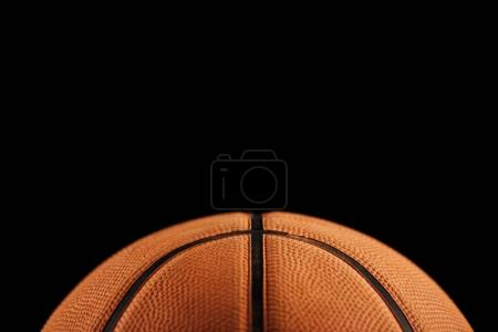Photo for Close-up view of traditional basketball ball isolated on black background - Royalty Free Image