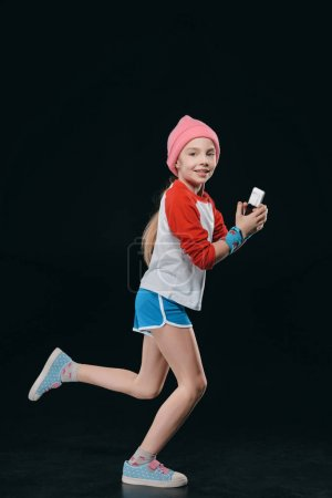 girl in sportswear using smartphone
