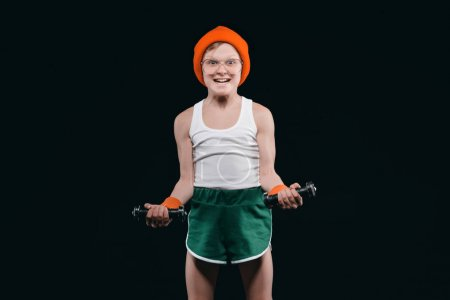 boy training with dumbbells