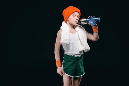 Sporty boy drinking water