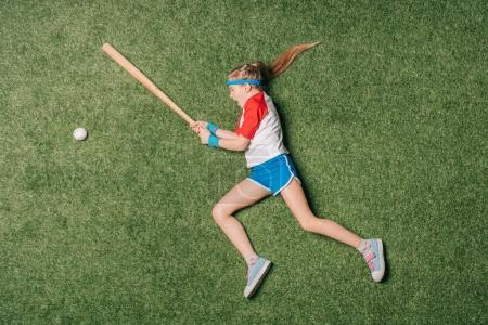 Photo for Top view of little girl pretending playing baseball on grass, athletics children concept - Royalty Free Image