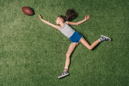 Girl with rugby ball