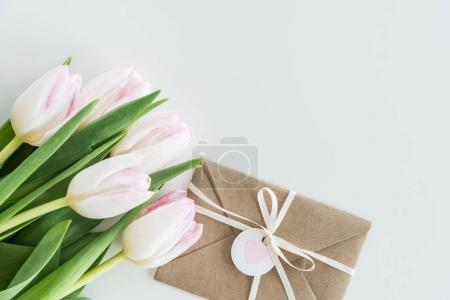 Photo for Light pink tulips and envelope isolated on white with copy space, wedding cards flowers concept - Royalty Free Image
