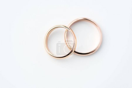 Photo for Two golden wedding rings isolated on white, wedding rings background concept - Royalty Free Image