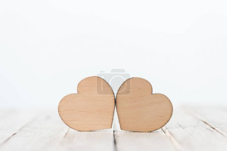 Photo for Close-up view of decorative wooden hearts symbols on white - Royalty Free Image