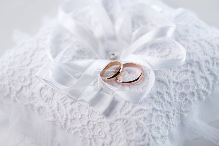 Wedding rings on lace pillow