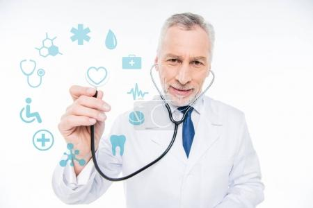 Photo for Confident doctor with stethoscope and medical care icons - Royalty Free Image