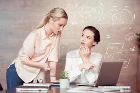 Photo for Confident young businesswoman with female colleague at office - Royalty Free Image