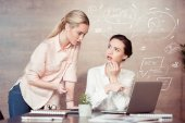 businesswoman with female colleague at office