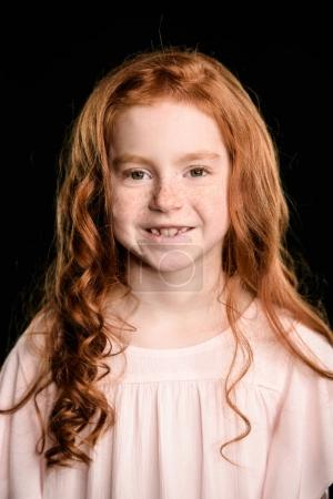 Photo for Portrait of adorable redhead girl smiling and looking at camera isolated on black - Royalty Free Image