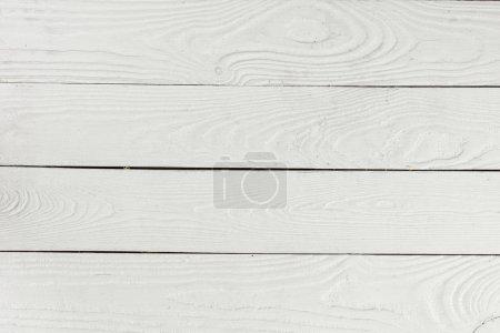 Photo pour Vue rapprochée du blanc texturé en bois fond de planches de bois - image libre de droit