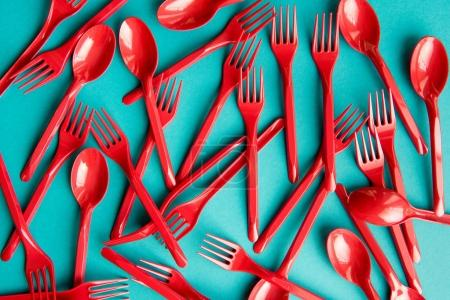 Photo for Top view of set of plastic forks and spoons isolated on blue - Royalty Free Image