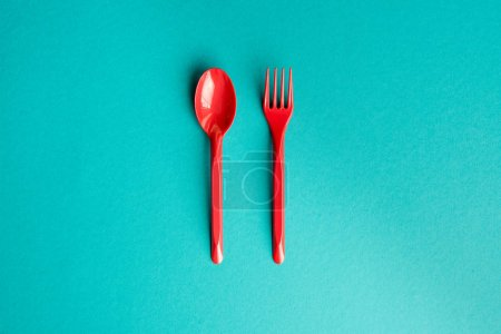 Photo for Top view of set of plastic fork and spoon isolated on blue - Royalty Free Image