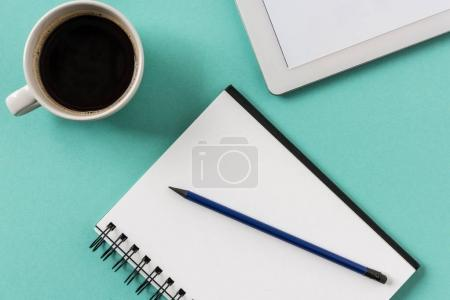 notebook with cup of coffee and digital tablet