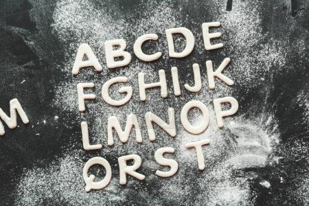 dough for cookies in forms of letters