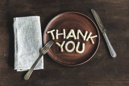 Photo for Top view of thank you lettering made from cookie dough on wooden plate - Royalty Free Image