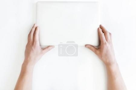 Photo for Top view of human hands and laptop computer isolated on white, wireless communication concept - Royalty Free Image