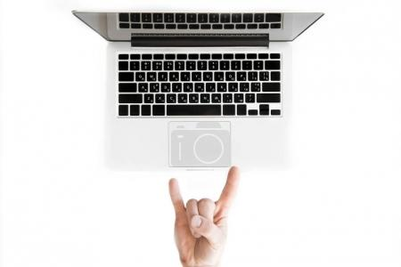 Photo for Top view of human hand with rock sign and laptop computer isolated on white, wireless communication concept - Royalty Free Image