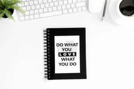 Photo for Flat lay with do what you love what you do motivational quote on diary, computer mouse and keyboard isolated on white - Royalty Free Image