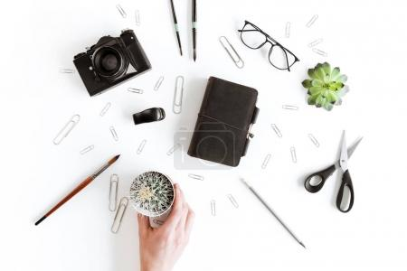 Human hand and office supplies