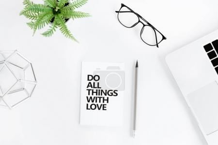Photo for Flat lay with Do all things with love motivational quote on modern workplace with laptop - Royalty Free Image