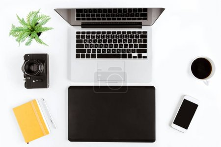Photo for Flat lay with various wireless devices and coffee cup on modern workplace - Royalty Free Image