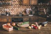 """Постер, картина, фотообои """"Сырые овощи на кухонном столе"""""""