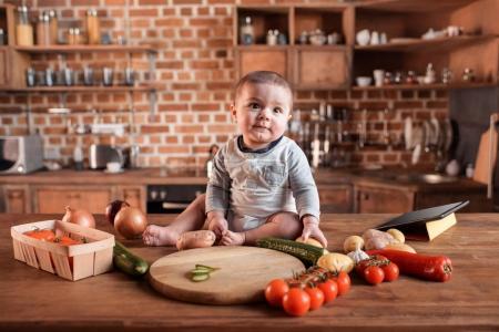 Little boy on kitchen table